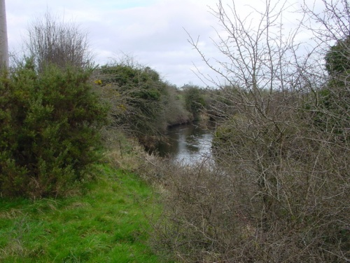 The river sweeping down towards the quay site