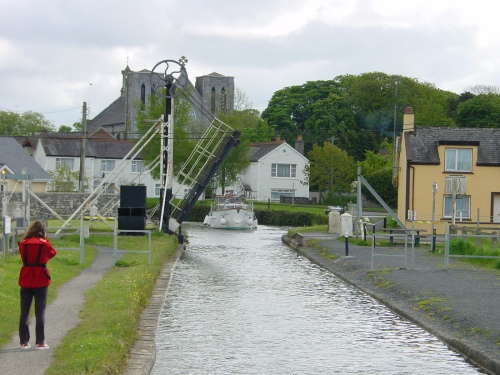 A boat approaching the drawbridge and the aqueduct