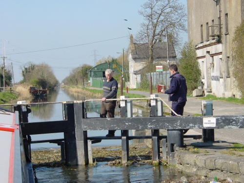 Filling the 12th Lock. Note the Omer lockhouse in the background