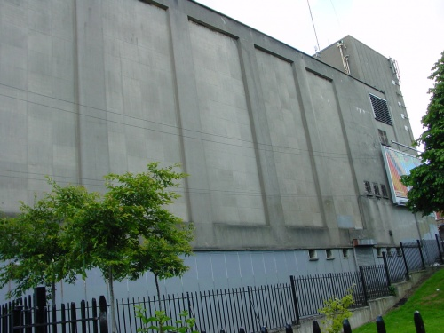 The wall of the cinema dominates the steps