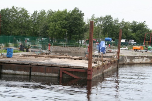 Large WI pontoon outside the dry dock at Roosky