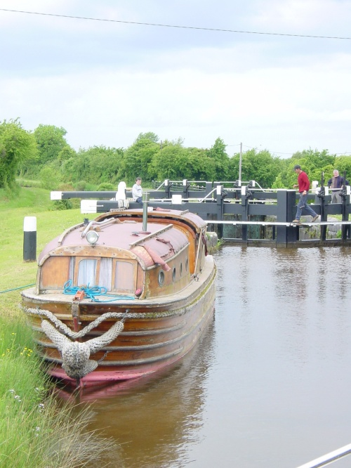 Wooden narrow cruiser above Lock 24 on the Grand Canal