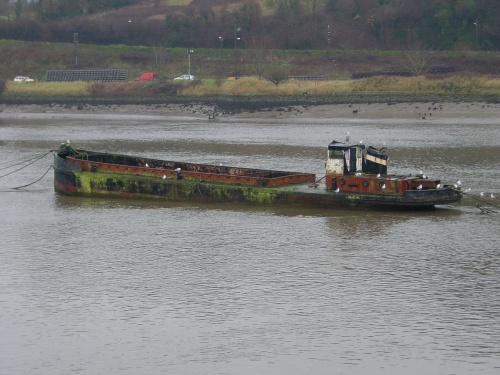 Former Guinness Liffey barge on the Suir in Waterford