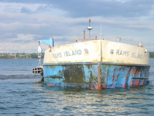 The sand barge Rams Island with its suction hose raised