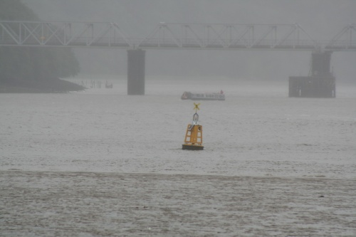 NB Earnest passes under Barrow Bridge in the rain