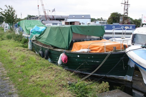 Green boat afloat