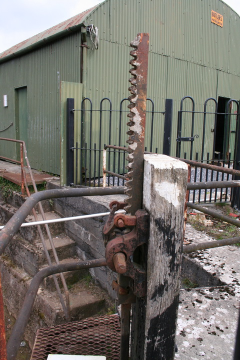 The mechanism (with the covered dry dock behind it)