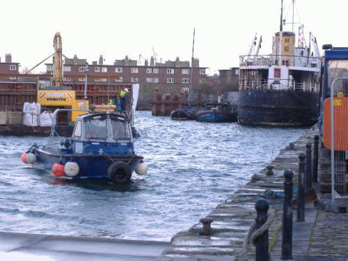 small boat towing large dumb barge (Paul Quinn)